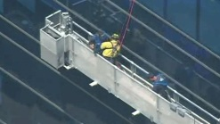 Firefighters Rescue Trapped Window Washers