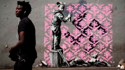 Graffiti Artist Banksy Splashes Paris With Works on Migrants