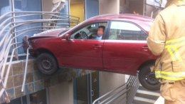 Car Crashes Into Building, Traps Driver