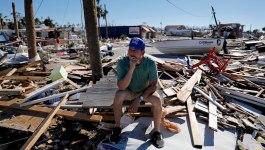Hurricane Survivors Wander Debris, Search for the Missing