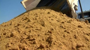 Tons of Sand Dumped on Downtown Pier