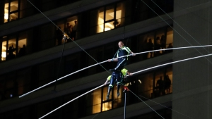 Flying Wallendas Safely Cross Times Square on a High Wire