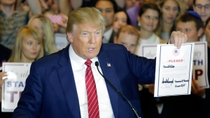 WATCH: Trump Signs GOP Pledge to Support Eventual Nominee