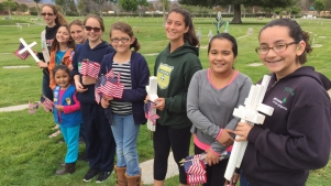 Girl Scouts Use Cookie Money to Replace Stolen Flags at Cemetery