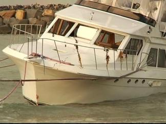 Damage Yacht Towed Ashore