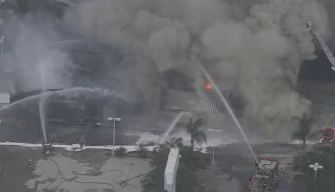 Firefighters Battle Flames, Thick Smoke in Abandoned Building Fire