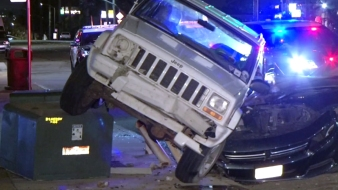 Jeep Crashes Into Car, Lands on Transformer