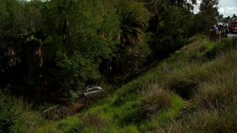 Car Flies 50 Feet Down Ravine
