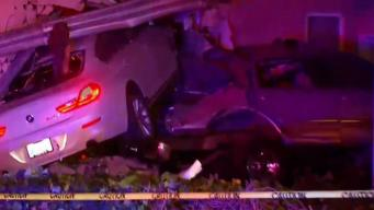 Car Jumps Guardrail Slams into Point Loma Home