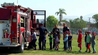 Children Bond With Officers and Firefighters in City Heights