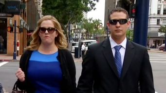 Ex-Cop's Wife Curses After Hubby Held Over for Trial