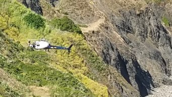 Man, Two Teens Rescued After Spending Night on Cliff