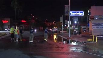 Sheared Hydrant Spurs Sinkhole in El Cajon