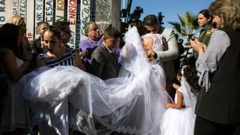 Families Reunite When Gates Open at US-Mexico Border
