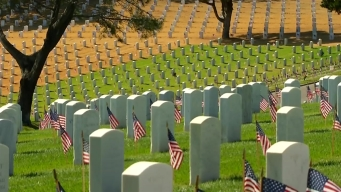 Volunteers Place Flags on Graves at Fort Rosecrans