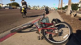 Motorcyclist and Bicyclist Crash in Midway Area