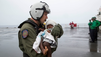 Navy Ship Rescues Group, Infant Lost at Sea