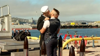 First Gay Men to Share Ceremonial First Kiss