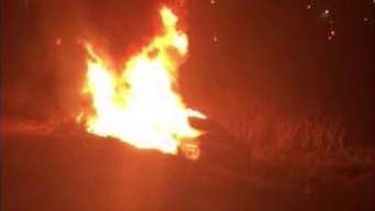Deputy Saves Woman From Burning Car