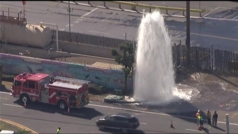 Broken Hydrant Spews Water High Into Air