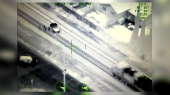 Police Chopper Stops Train From Hitting Stalled Car