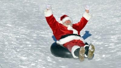 Snow-Tubing Santa, a Seasonal Big Bear Sight