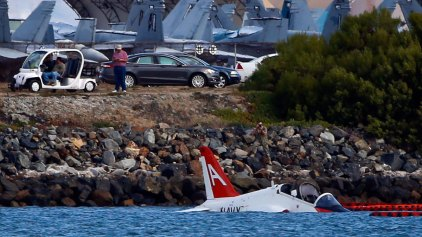 Pilot Ejects When Plane Runs Into Bay