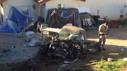 Car Plows Through Wall, Lands in Yard