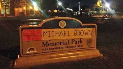 Slain Officer's Name Covered by Protesters' Sign
