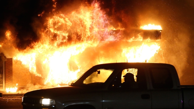 At Least a Dozen Ferguson Businesses Burn