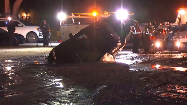 Watch: Crews Pull Car From Sinkhole in Escondido
