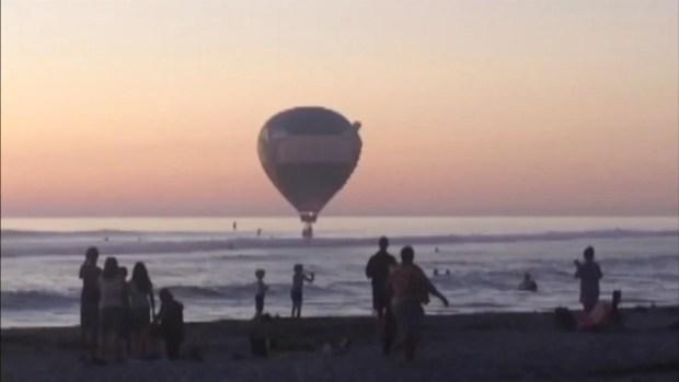 WATCH: Hot Air Balloon Lands in Surf