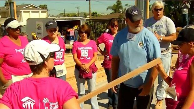 Volunteers Ignore Heat to Build Homes