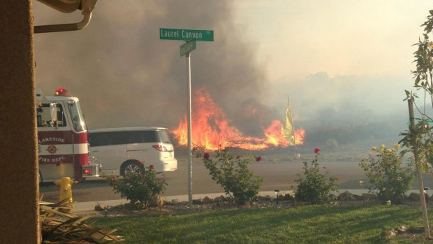 Grass Fire Burns Near Lakeside Homes: Images