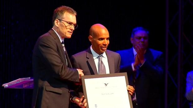 Olympian, Marathon Legend Honored by USCIS