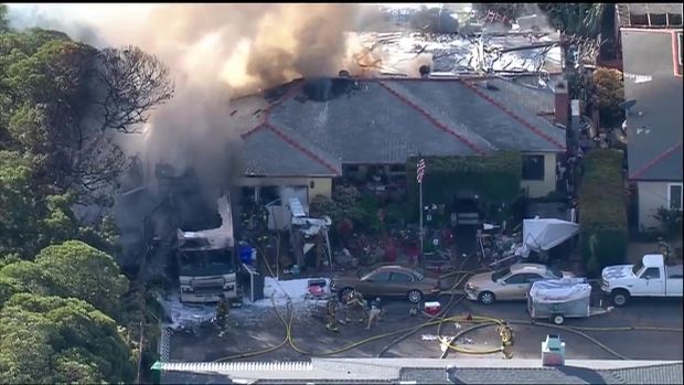 Raging Fire Rips Through RV, Home in Oak Park - NBC 7 San Diego