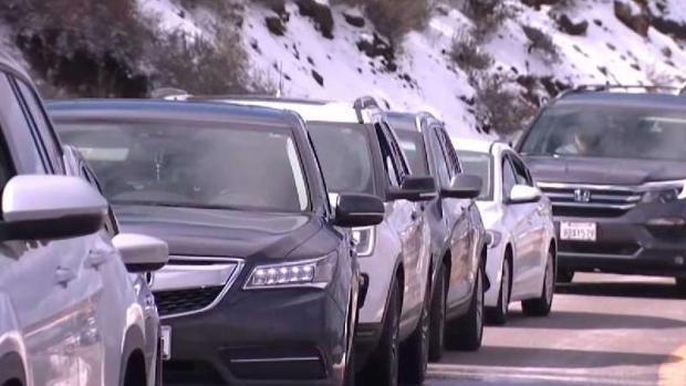 Traffic Delays Holiday Fun in Snow