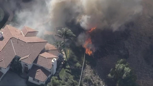 [NATL-LA] Fire Crews Battle to Save West Hills Home