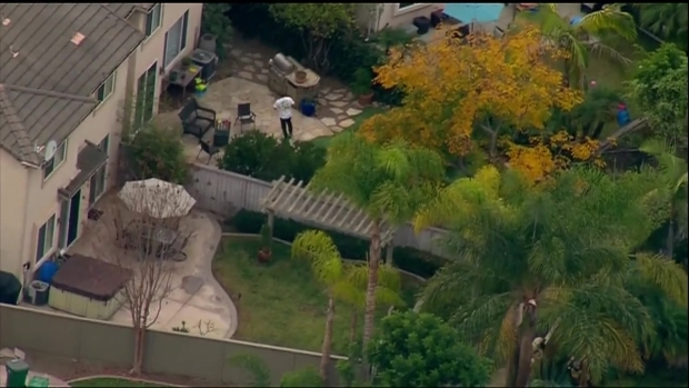 Watch: Bank Robbery Suspect Hops Fences in Chase