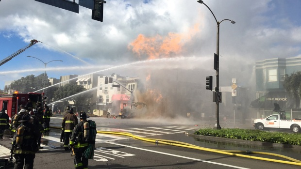 Photos Show Towering Flames as Crews Fight SF Inferno
