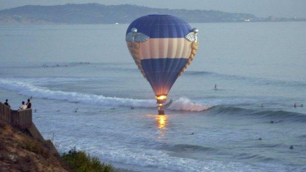 Hot Air Balloon Landing Near Ocean: Images