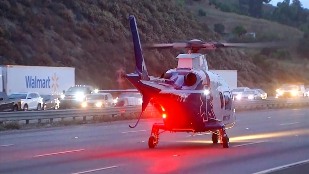 Helicopter Lands on I-15 to Aid Person Injured in Crash Near