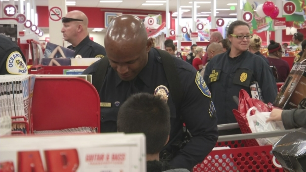 At 'Shop with a Cop' Event, Kids Go on Shopping Spree with Officers