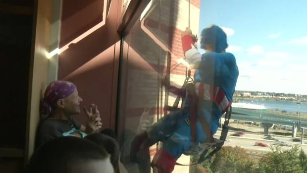 [NATL-DFW] Superhero Window Washers Brighten Children's Day