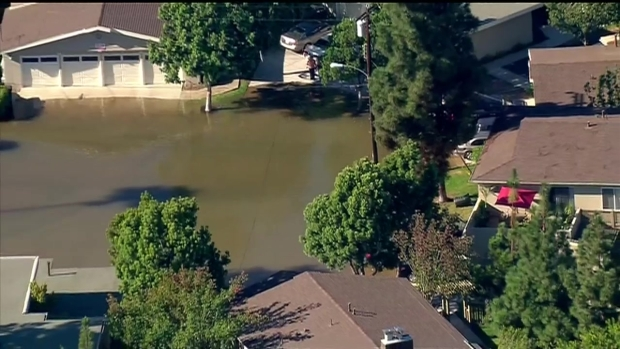 RAW VIDEO: Water Main Break Floods Neighborhood