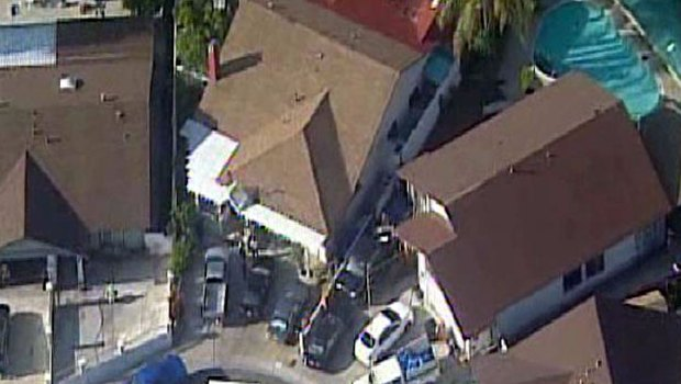 Images: Bodies Found in Backyard of Bay Terraces Home