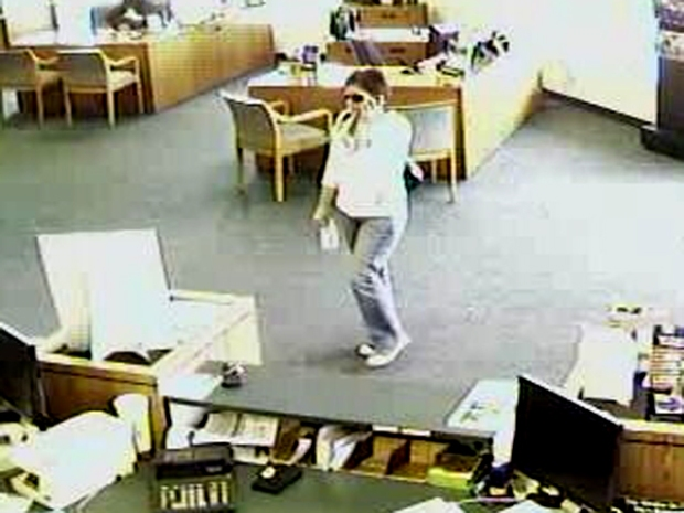 Woman on Phone Robs Bank