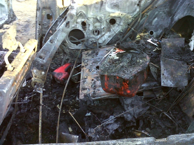 Images: Burned Body Found in Car