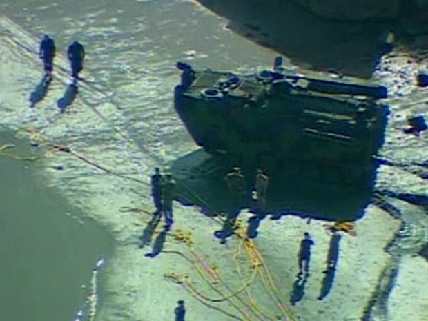 Divers Search for Submerged Military Vehicle