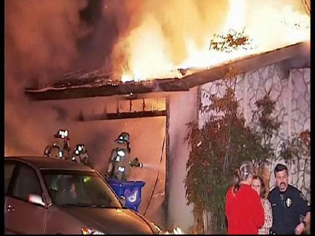 [DGO] Neighbors, Cops Rescue Woman From Fire